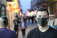 Urban picture of young man with pollution mask royalty free stock photography