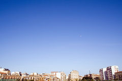 Urban Planet. Urbanscape with blu sky and the moon stock image