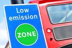 Urban pollution. Concept with bus passing low emission zone Stock Images