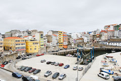 Urban port and car parking in town Malpica. MALPICA DE BERGANTINOS, SPAIN - JULY 15: urban port and car parking in center of town. Malpica is town on Royalty Free Stock Images