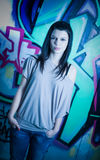 Urban portait of a beautiful young brunette. Stock Photo
