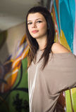 Urban portait of a beautiful young brunette girl. Royalty Free Stock Photography