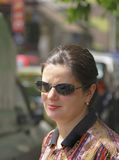 Urban portrait. Of a woman wearing sunglasses in a sunny day Royalty Free Stock Photo