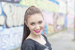 Urban portrait of beautiful happiness young woman. Royalty Free Stock Image