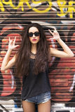 Urban portrait of beautiful woman rock lifestyle on urban backgr Royalty Free Stock Image