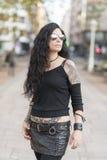 Urban portrait of beautiful woman with sunglasses heavy metal st Stock Photo