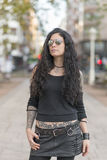 Urban portrait of beautiful woman with sunglasses heavy metal st Stock Photos