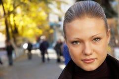 Urban portrait of a girl. Urban outdoor portrait of a pretty girl, autumn background Stock Photos