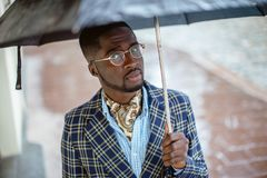 Urban portrait of handsome African American businessman standing Royalty Free Stock Photos