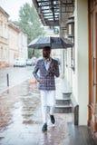 Urban portrait of handsome African American businessman standing Stock Photo