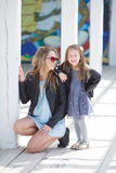 Urban portrait of happy mother with little daughter Royalty Free Stock Photography