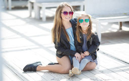 Urban portrait of happy mother with little daughter Stock Photography