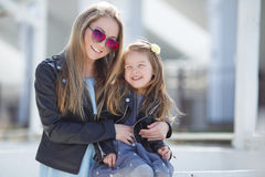 Urban portrait of happy mother with little daughter Stock Images