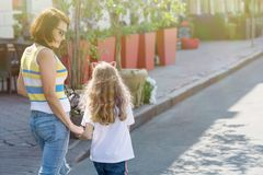 Urban portrait of mother and daughter. Royalty Free Stock Images