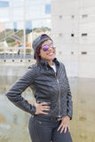 Urban portrait of smiling fashion latin woman with sunglasses and baseball cap. Royalty Free Stock Photo