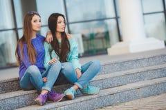 Urban portrait of two beautiful girlfriends. Royalty Free Stock Photos
