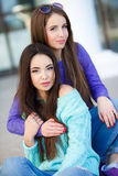 Urban portrait of two beautiful girlfriends. Royalty Free Stock Photo