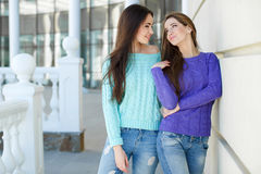 Urban portrait of two beautiful girlfriends. Stock Photography