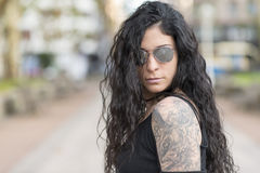 Urban portrait of woman with sunglasses heavy metal style. Royalty Free Stock Photo
