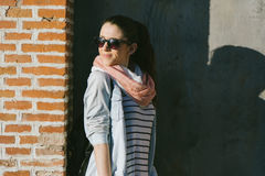 Urban portrait of woman wearing sunglasses, smiling Stock Photos