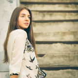 Urban portrait of young hipster girl on stairs Royalty Free Stock Photos