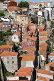 Urban Portugal. A collection of houses in Porto, Portugal, near the river. Adobe roof tiles and hanging laundry adorn the scene Royalty Free Stock Images