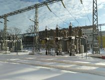 Urban power grids, transformers and electrical wires. stock photos