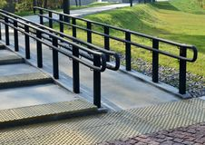 Urban railings, handrails for pedestrians. Stairs and paving slabs stock photography
