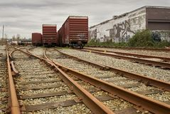 Urban Railroad Tracks and Cars Stock Images