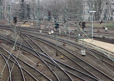 Urban Railroad Tracks Junction with Switch and Platform Royalty Free Stock Photography