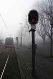 Urban railway track with red signal light Royalty Free Stock Image