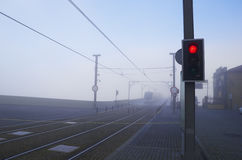 Urban railway tracks with red signal light Stock Photos