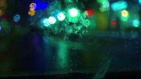 Urban rainy busy night. Artistic bokeh video. Clip stock video