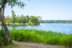 Urban Recreational Lake Park. Lake for boating and swimming surrounded by walking path in city. Copy space stock image