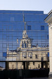 Urban reflection. Abstract tower's reflection  in windows of modern building Stock Photos