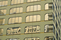 Urban reflections on office building Royalty Free Stock Photos