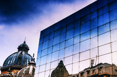 Urban reflexions. CEC Palace in Bucharest and some other reflexions Royalty Free Stock Image