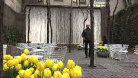 Urban resting area with artificial waterfall. Urban resting area in NYC stock video footage
