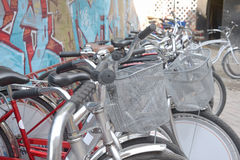 Urban retro bicycle, service and Bicycle rental. Many colorful Bicycles stanging in a row Royalty Free Stock Image