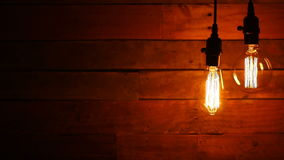 Urban Retro Hanging Light Bulbs on Wood Background stock video footage