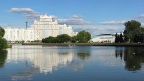 Urban river in Minsk flying seagull. Minsk Nemiga river city general plan stock footage