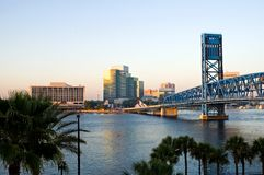 Urban river view and bridge. An early morning view along the banks of the St. John's River in Jacksonville, Florida with office buildings and a major draw bridge Royalty Free Stock Photo