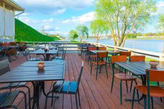Urban riverfront cafes. And green trees Stock Photo