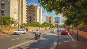 Urban road along condominiums exterior Royalty Free Stock Photo