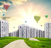 Urban road and buildings at sunset. With hot air balloons. Mixmedia Stock Image