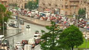 Urban road with cars and pedestrians Russia Moscow. Road and the cars in  city and pedestrians on the sidewalks stock footage