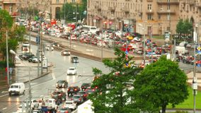 Urban road with cars and pedestrians Russia Moscow. Road and the cars in  city and pedestrians on the sidewalks stock video footage