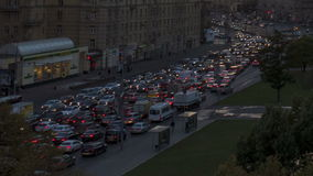 Urban road with cars and pedestrians Russia Moscow. Road and the cars in  city and pedestrians on  sidewalks stock footage