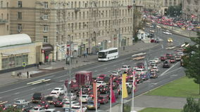 Urban road with cars and pedestrians Russia Moscow. Road and the cars in  city and pedestrians on  sidewalks stock video footage
