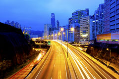 Urban road with light trails in Hong Kong stock images